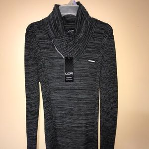 Grey Stretchy Turtle Neck sweater.